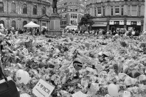 A floral tribute to a terror attack, many of the flowers have 'I love MCR' poster cards attached to them.